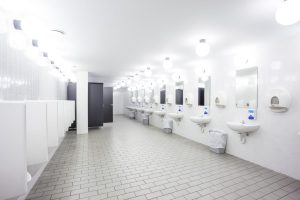 urinals and sink in an old building for men only